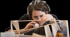 A woman constructing a modal building.